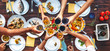 Leinwandbild Motiv Big family dinner. Vertical top view on served table and hands with clinking goblets