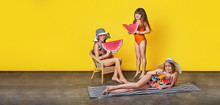 Group Little Girl In Swimwear,summer Concept. Beautiful Funny Three Children Resting On Vacation. Studio Isolated Yellow Background. Banner,copy Space For Text,shop,advertising. Fashion Models Kids.