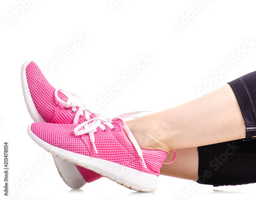 Foto op Plexiglas Fitness Female legs sports leggings sneakers sports exercises on a white background isolation