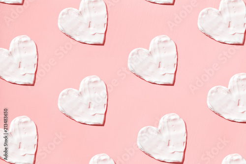 Fotomural  Hearts pattern from cream in pink background. Skin care