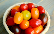 Tomato Varieties ,Type And Color Mixed Together In Basket On Wooden Floor. A Lot Kind And Different Color Of Tomatoes.