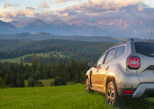 Suv On A Mountain Meadow
