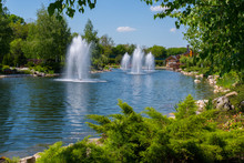 Magnificent Blue Clear Lake With Several Beating Fountains In The Rays Of The Bright Sun