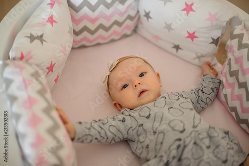 6eff9d412 Little cute girl with a bow on her head lying in her cozy bed - Buy ...