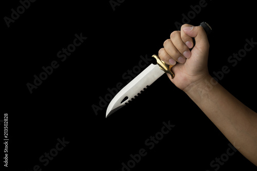 Photo  close up of hand holding a combat knife, isolated on black background with clipp