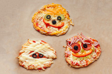 Halloween Pizza With Monsters, Above Scene With Decor On A Craft Paper Box Background, Idea For Home Party Food, Easy, Healthy And Delicious Fun Food Party Treats For Kids