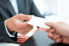 Business People Change Business Cards On Meeting Seminar Or Conference.