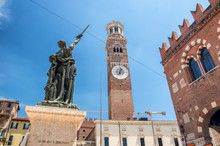 A Street View Of Piazza Delle Erbe And Lamberti Tower In Verona