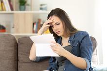 Concerned Woman Reading Bad Ne...