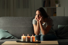 Frustrated Woman Sitting At Home During A Blackout