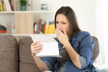 Sad Woman Reading Bad News In A Paper Letter