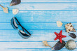 Sea Shells Decorations Sunglasses And Sea Star On Blue And White Painted Wood Background High Contrast Summer Concept