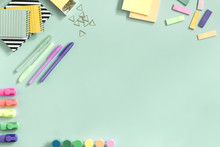 The Top View Of Creative Desk With School Accessories, Notebooks And Colorful Markers. Pastel Color Background With Copy Space For Inscription. Back To School.