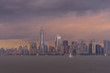 Panorama view of NYC Lower Manhattan skyline with sailboats passing by in New York Harbor