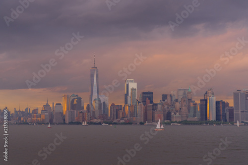 Photo Stands New York Panorama view of NYC Lower Manhattan skyline with sailboats passing by in New York Harbor