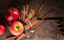 Cinnamon Sticks And Ripe Apple...
