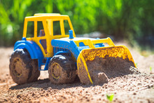 Toy Tractor In The Sand
