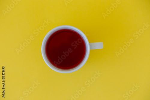 Fototapeta Cup of tea on a yellow background top view. obraz na płótnie