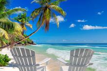 Beach Chairs On Sandy Beach Wi...