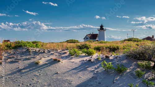 Spoed Fotobehang Centraal-Amerika Landen Lighthouse Point on beach dunes, Race Point Light Lighthouse in Cape Code, New England, Massachusetts, USA.