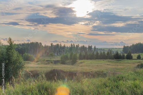Foto op Canvas Bleke violet rural landscape in the Chuvash Republic,filmed against the sun