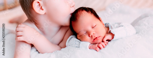 Big Brother Kissing Sleeping Newborn Baby Sister At Home Banner Buy This Stock Photo And Explore Similar Images At Adobe Stock Adobe Stock