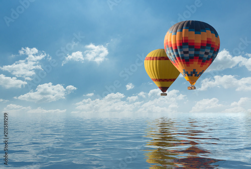 Colorful hot air balloon fly over the blue sea