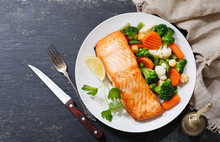 Plate Of Baked Salmon Steak Wi...