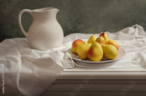 still life with pears on wooden table