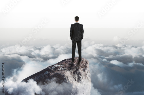 Photographie  success concept with businessman onn top of rock