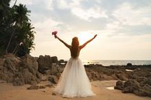 Bride Wearing Beautiful Wedding Dress On The Beach