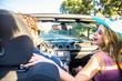 Couple on convertible car