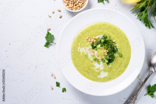 Fotografie, Tablou Zucchini Cream soup on white.