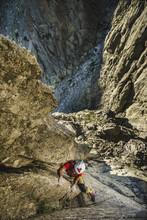 Climber Climbing A Steep  Crack On Granite  Wall
