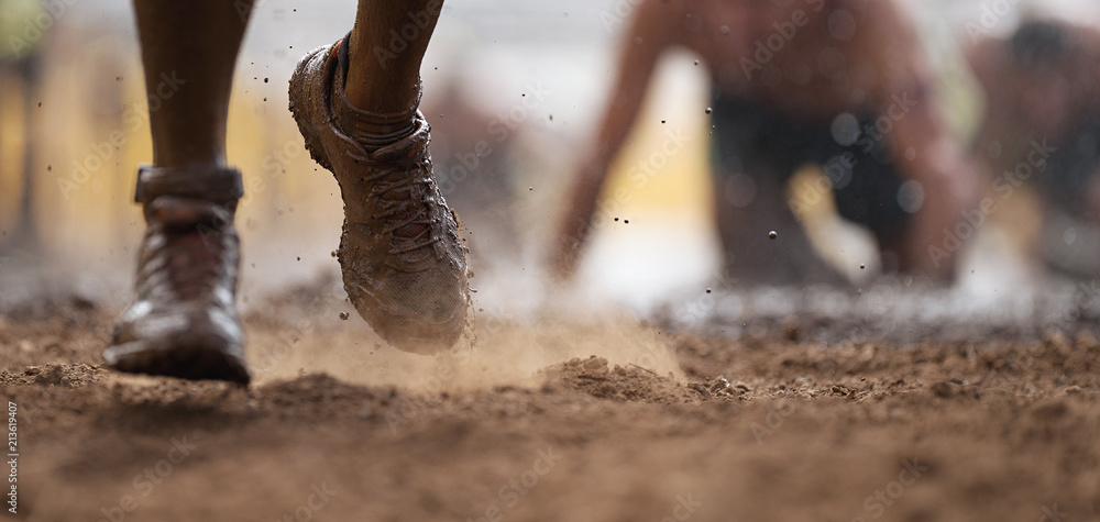 Fototapety, obrazy: Mud race runners.Crawling,passing under a barbed wire obstacles during extreme obstacle race