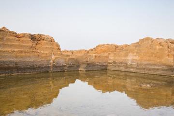 Fototapeta na wymiar Estanque de agua y su reflejo