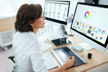 Web Designer Working On Computer