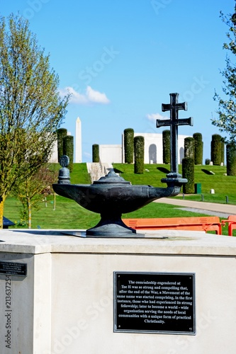 Valokuva  Front view of the Armed Forces Memorial with landscaped gardens and the Toc H Christian lamp memorial in the foreground, National Memorial Arboretum, Alrewas, UK