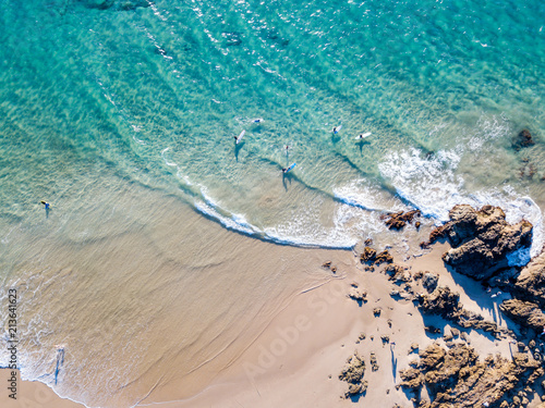 The Pass and Wategoes Beach at Byron Bay from an aerial view with blue water