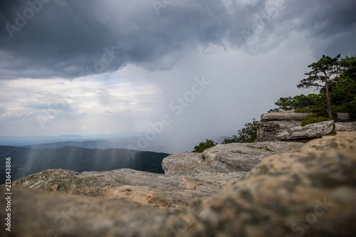McAfee Knob on Appalachian Trail while raining in the valley rock in the foreground Fotobehang