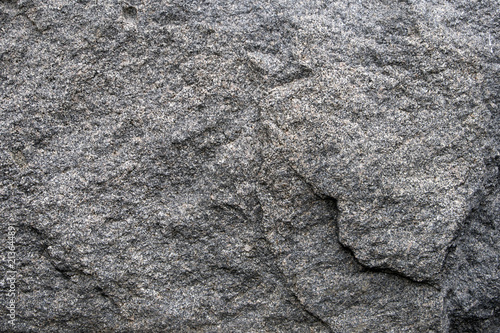 Tuinposter Stenen Gray natural stone texture, relief granite surface, may be used as background