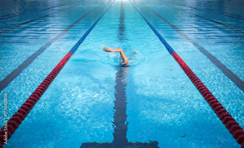 one man swimming on swimming pool lane