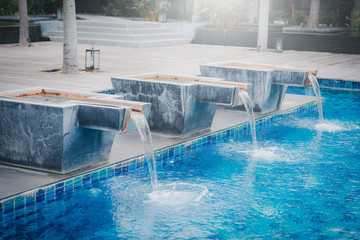 Waterfall jet at the swimming pool on daytime.