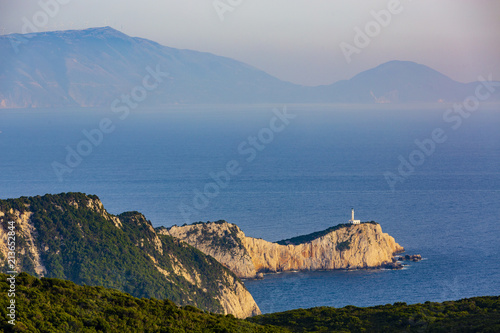 Spoed Foto op Canvas Europa Sunset view with magical lighthouse over Cape of Doukato, Lefkada island in Ionian Sea, Lefkas, Greece