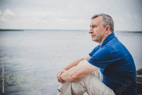 Fotografie, Obraz  Mature European man with a sad philosophical mood