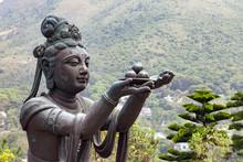 Buddhist Statues Praising And Making Offerings To The Tian Tan Buddha (the Big Buddha) At Lantau Island, In Hong Kong.