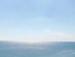 shiny black sea under a blue sky background