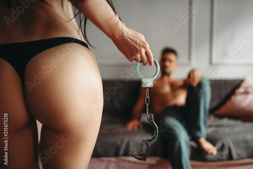 Deurstickers Ezel Woman with seductive ass standing against man