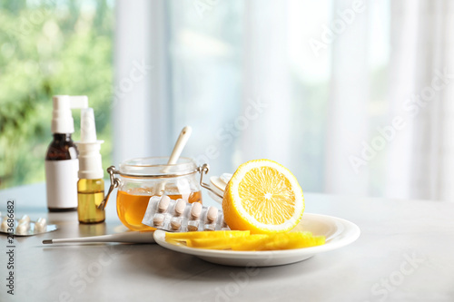 Photo Natural and medical cold remedies on table