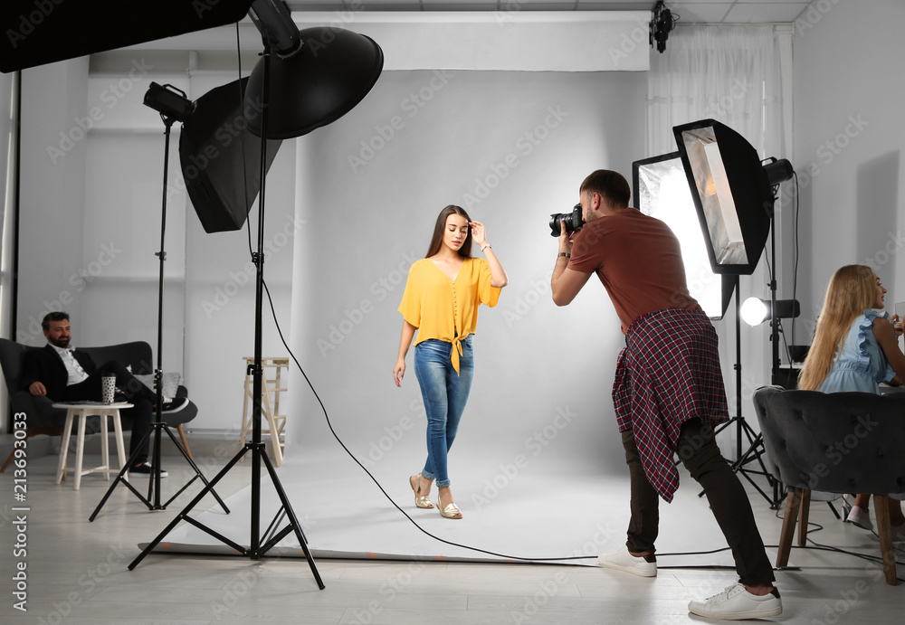 Fototapety, obrazy: Professional team working with model in photo studio